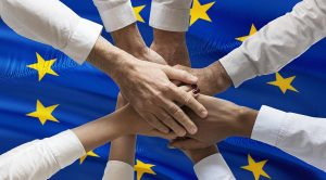 European Solidarity Now! Multiple Hands in Front of Europe Flag
